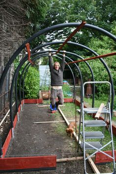 Easy DIY Greenhouse Plans (They're Free!) - Building a greenhouse does not have to break your budget. There are cheap and simple to construct greenhouse plans out there, and under you'll . *** Click image to read more information. Diy Greenhouse Plans, Backyard Greenhouse, Small Greenhouse, Greenhouse Vegetables, Greenhouse Wedding, Homemade Greenhouse, Greenhouse Plants, Greenhouse Film, Tunnel Greenhouse