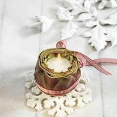 Make your own candleholders to decorate your table at Christmas.