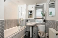 photo of calming clean modern beige grey white bathroom with blind mirror tiles White Subway Tile Bathroom, Gray And White Bathroom, Beige Bathroom, Laundry In Bathroom, Bathroom Cabinets, Master Bathroom, Bathroom Vanities, Tiny Bathrooms, Amazing Bathrooms