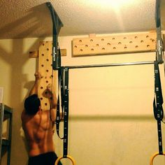 DIY Peg Board in action. A fun, yet very effective training tool. #crossfit #garagegym #weightlifting #rockclimbing #roguefitness #powerlifting #fitness #homegym #pegboard #diy