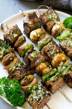 These steak kabobs are pieces of sirloin beef skewers with mushrooms, peppers and onions, then grilled to perfection and finished off with garlic butter.