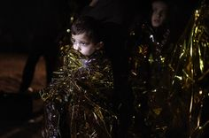 A boy looks on after arriving with other migrants and refugees on the Greek island of Lesbos after crossing the Aegean sea from Turkey