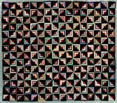 "circa 1900  made by Rawlings, Hanna (Mrs. Richard)  Origin: 	Cutlerville, USA  Description:	Two hundred twenty-four, 4 5/8"" squares were made of strips of brightly colored silk and sateen on one half and strips of black sateen on the other. The center is a square of bright red fabric. Cotton shirting fabrics were used as the foundation. There is no backing, filling, or binding."