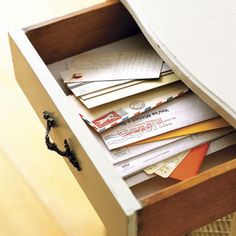 Drop off mail at a mail station just inside your door. Trays and bins work well on tables, and mounted wood or metal files will do the job for those with ample wall space. #organizationtips