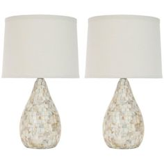 Add light and contemporary beauty to your home with this two-piece table lamp set. Featuring a smooth mother-of-pearl design and classic white linen shades, these elegant lamps will stand out without overpowering the rest of your decor.