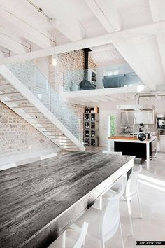 Stripped wood, bare brick kitchen