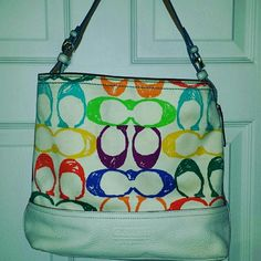 """Coach Poppy purse White Coach Poppy purse with colorful """"C's"""" all over it!  White leather bottom with a canvas body. Leather strap. Looks brand new. 25% off bundles of 3 :-) Coach Poppy Bags Shoulder Bags"""