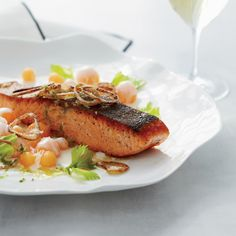 Salmon with Cantaloupe and Fried Shallots | Salmon recipes include triple-mustard salmon and Chef Thomas Keller's smoked salmon crisps. Find more recipe ideas for Salmon from Food & Wine.