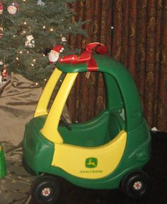 Goodwill Cozy Coupe spray painted and turned into John Deere Tractor. We celebrated christmas early and Hudson LOVED it!