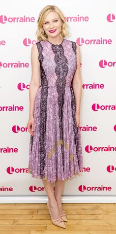 Kirsten Dunst was picture-perfect on the set of Lorraine in a sweet lilac-and-plum lace midi dress, complete with a fuchsia lip and ladylike nude pumps.  Look of the Day | InStyle.com