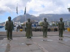 Nobel Square - Cape Town, Western Cape South Africa. The four statues represent 4 South Africans that have won the Nobel Peace prize. These are, from left to right: Nkosi Albert Luthuli, Archbishop Emeritus Desmond Tutu, former State President F.W. de Klerk and former President Nelson Mandela.
