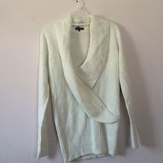 Plunge Shimmer Sweater (Never Worn) (size S) Size small. Never worn. Tags attached. Off white/creme color. Shimmers. Beautiful! Fits many body types well due to style and for! Plunge v neck. Thick and warm! Sweaters