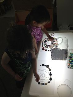 Light Table Mandalas with various materials. We've used buttons, glass beads, shells, and bottle caps.The children are constantly looking for more small material collections to use in their...