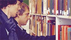 """""""Seriously Benedict, how can you pick up like 7 books at once. (gif)"""" - Really, how is that even possible?  Sherlock and John at the library, of course."""