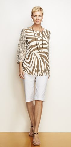 Show off your wildly chic style with this zebra-print top. Moda Anni   f363f20cd8f