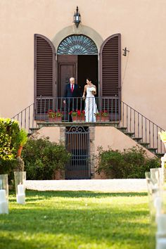 Being walked down the steps of a Tuscan villa. Wedding Venue: Villa Il Pozzo in Certaldo, Tuscany, Italy.