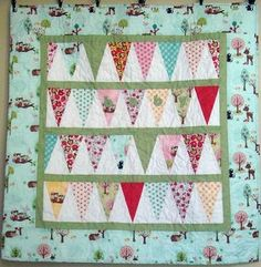 """Banner baby quilt measures 35x35"""" - the pattern is no longer available but it could be figured out."""