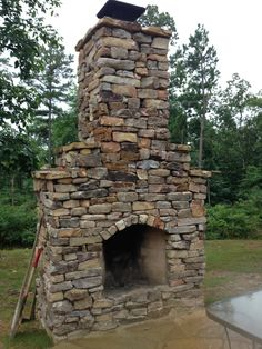 Outdoor dry-stacked Rumford Fireplace by Lord Brothers Masonry LLC