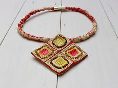 Items similar to Red Necklace Dragon Eye on Etsy Handcrafted Jewelry, Unique Jewelry, Dragon Eye, Crochet Necklace, Trending Outfits, Jewellery, Silk, Beads, Handmade Gifts
