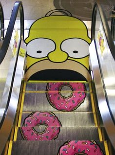 Homer Simpson Escalator, complete with frosted donuts that pop directly into his big mouth on a consistent basis!