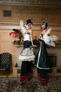 Masquerade Holiday Party in The Lodge at The Regency Center like no other...Aerialists, Opera singers, #feathers, #masks and bejeweled florals abound!   Photographer: Gustavo Fernández Photographer  Florals: Soulflower Design Studio, come visit us at http://soulflowersf.com/