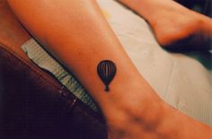 I want this but a little bit bigger, rainbow colored, and on my wrist. It would represent my mom