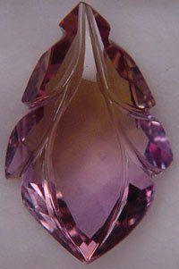 Artistic Colored Stones: Fantasy Cut Ametrine Ametrina, também conhecido como trystine ou pelo seu nome comercial como bolivianite