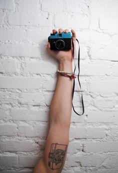 i love the idea of a camera tattoo.