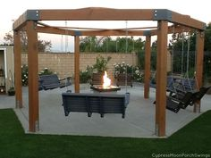 pergola with swing and fire pit | http://www.CypressMoonPorchSwings.com …