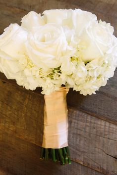 Hydrangeas and Polo Roses - like this but with the matching navy ribbon instead of cream.