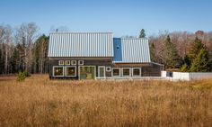 Salmela Architect has created a rural Wisconsin home that features a steep roof, square windows and natural cedar cladding meant to age over time.
