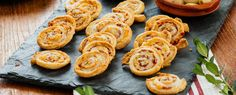 Having a stash of these pinwheels in the freezer makes last-minute entertaining a breeze. We like to serve these on a cheeseboard with a small pot of fig jam—the figgy sweetness goes so nicely with the savory salami. It's worth seeking out all-butter puff pastry, which offers a much better flavor than one made with oil.