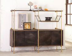 The Collector's Shelving System is fully adjustable and designed to be  configured for any space. The oak shelves and credenza are available in a  variety of finishes. The framework is available in solid brass or steel  with multiple metal finishes to choose from.This price is for the unit as  s