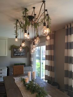 Gorgeous Spider Chandelier!  A Wonderful Customer Installation with vines and burlap.