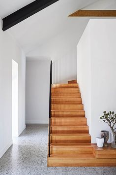 The Tasmanian oak stairs lead to the master suite in this country farmhouse with modern interiors | Photography by Anson Smart | Styling by Jono Fleming