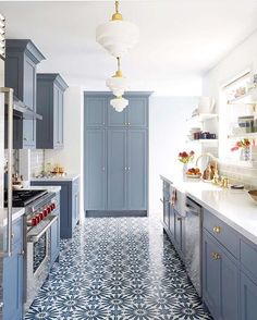 More than just a crush, we've found true blue LOVE!  From those gold pendants, to the cabinetry, to that crazy-gorgeous tilework - @ginny_macdonald, this kitchen is perfection.  #MyOKLStyle [: @zekeruelas] #regram