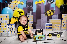 Very first cake for Batman boy! Cakesmash decor, yellow, blue, black, bat mobile (batmobile), balloons, city, Gotham, studio, fun, smile, birthday