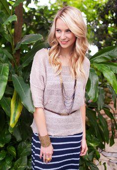 This loose weave sweater is the perfect pairing with a maxi skirt.  Great accessories as well.