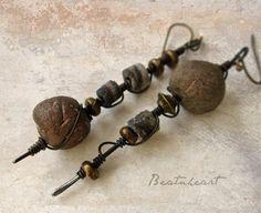 Our Worlds Collide. dangle earrings primitive tribal earthy rustic asymmetrical. $25.00, via Etsy.