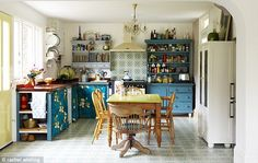 Lovely vintage style kitchen in bright colours and stunning tiles on the floor and wall.
