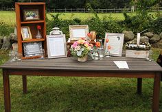 Gift table - framed pictures of parents weddings and us as kids. Wishing well, cards, gifts.