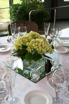 Square centerpiece on square mirror with rolley polley candle holders...  :)