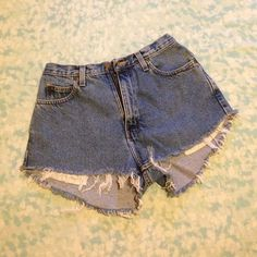 High Waisted Denim Shorts Laying flat, it's about 13 1/2 in. across the top. Down the center (crotch) it's about 11 1/2 in. long. On the sides, it's about 10 in. long and is the same length across the front until it meets the crotch. The back is at an angle, as you can see, so from the 10 in. on the side it goes down to 13 in. at it's longest point. They will fit almost exactly like the 3rd pic. Except it isn't cuffed in the front. It's also cut so that the sides go slightly higher. I think…