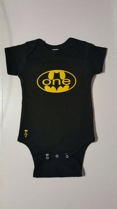 Check out this item in my Etsy shop https://www.etsy.com/ca/listing/398784895/batman-one-onesie-black-and-yellow-first