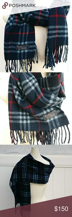 Luxury Burberry scarf. This gorgeous nova check traditional scarf is in excellent condition. Burberry's of London.  100% Lambswool. Dry clean only.  Made in England. Colors: Navy blue, Red, pale blue. Currently selling at Nordstrom's for $395. Reasonable offers always welcome. Burberry Accessories Scarves & Wraps