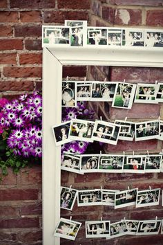 cute idea for reception. Have everyone take pictures with polaroid camera and pin up to wire in frames with clothes pins