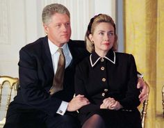 CLINTON President Clinton sits close to his wife Hillary Clinton at a ceremony March 3, 1997 where they launched a new series of public service announcements by the White House. REUTERS/Stringer
