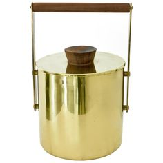 Italian Vintage Brass and Walnut Ice Bucket | From a unique collection of antique and modern barware at https://www.1stdibs.com/furniture/dining-entertaining/barware/