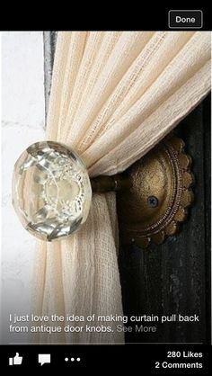 In love with this idea! Antique door knobs as curtain tie backs.