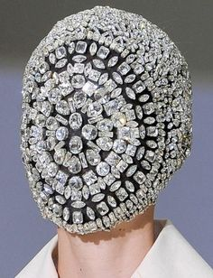 Not quite clear on the purpose.  o_O. Maybe it's a new Superhero mask.  (Maison Martin Margiela Mask, couture A/W12)